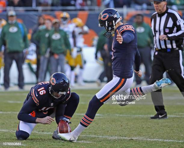 Cody Parkey of the Chicago Bears kicks a field goal out of the hold of Pat O'Donnell against the Green Bay Packers at Soldier Field on December 16...