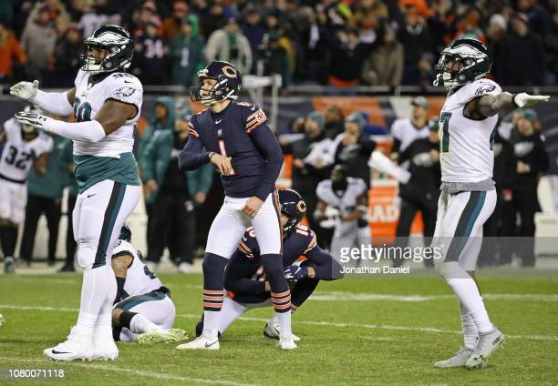 Cody Parkey of the Chicago Bears watches as his field goal attempt misses while Treyvon Hester and Malcolm Jenkins of the Philadelphia Eagles signal...