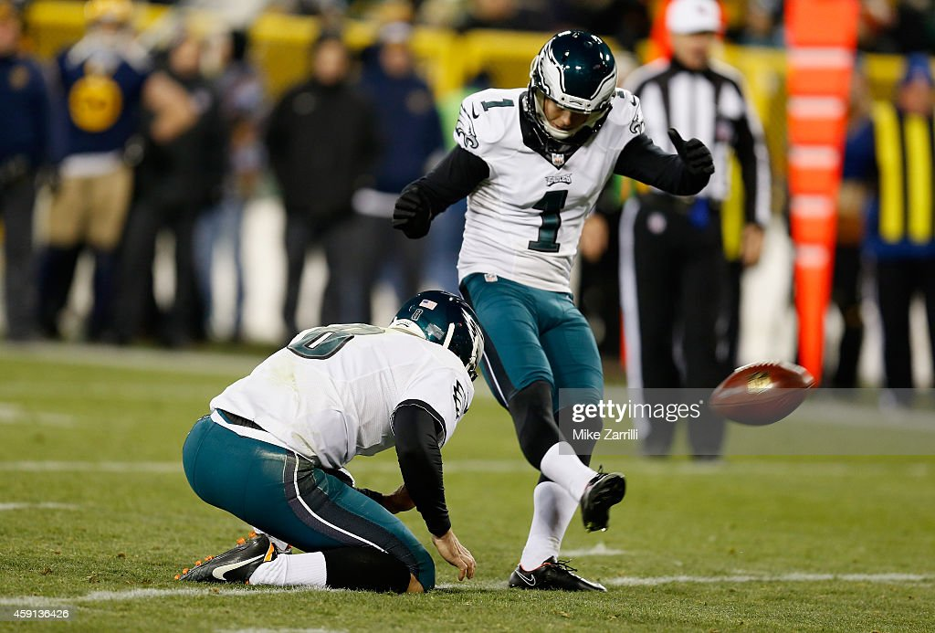 Cody Parkey #1 of the Philadelphia Eagles kicks for an extra point against the Green Bay Packers at Lambeau Field on November 16, 2014 in Green Bay, Wisconsin.