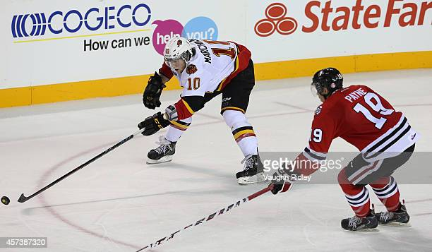 Cody Payne of the Niagara Ice Dogs chases Jake Marchment of the Belleville Bulls in an OHL game at the Meridian Centre on October 16, 2014 in St...