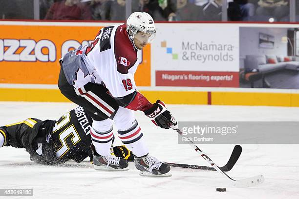 Cody Payne of the Niagara IceDogs eludes the fallen Nikita Korostelev of the Sarnia Sting at the Meridian Center on November 8 2014 in St Catharines...