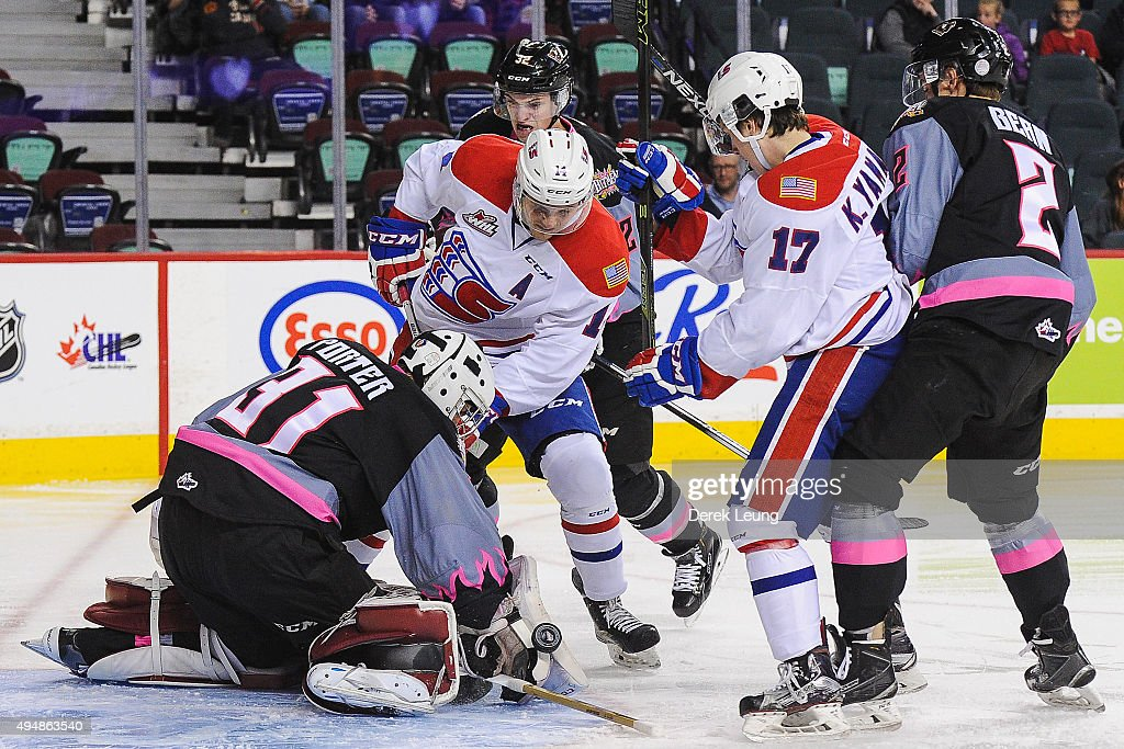 Cody Porter #31 of the Calgary Hitmen stops the shot of Adam Helewka #14 of the Spokane Chiefs during a WHL game at Scotiabank Saddledome on October 29, 2015 in Calgary, Alberta, Canada.
