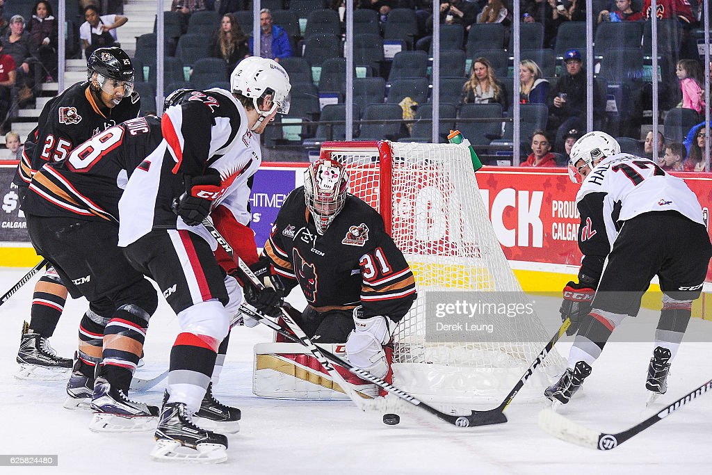 Cody Porter #31 of the Calgary Hitmen stops the shot of Noah Gregor #22 of the Moose Jaw Warriors during a WHL game at Scotiabank Saddledome on November 25, 2016 in Calgary, Alberta, Canada.