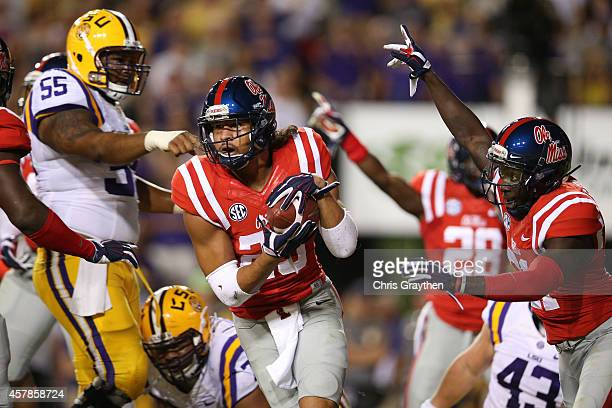 Cody Prewitt of the Mississippi Rebels recovers a fumble in the end zone against the LSU Tigers at Tiger Stadium on October 25 2014 in Baton Rouge...