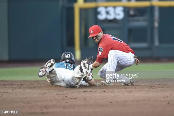 Cody Ramer of University of Arizona attempts to tag out the baserunner Kevin Woodall Jr of Coastal Carolina University during the Division I Men's...