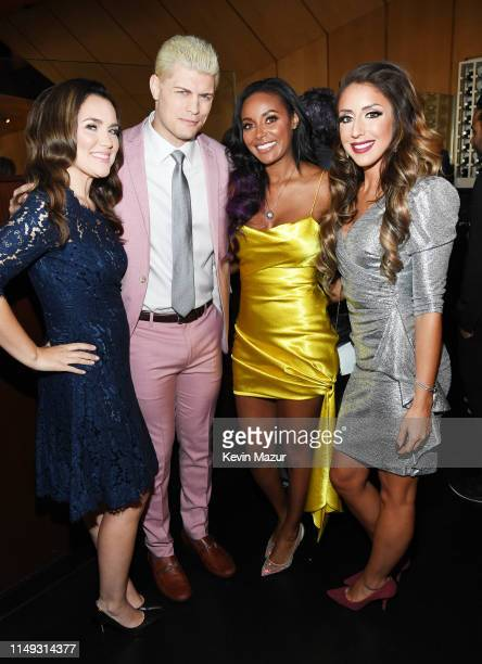 Cody Rhodes Brandi Rhodes and Dr Britt Baker of TNT's All Elite Wrestling pose in the WarnerMedia Upfront 2019 green room at Nick and Stef's...