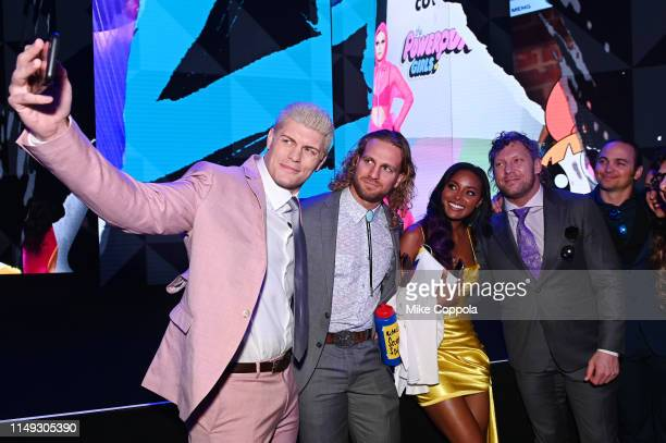 Cody Rhodes Hangman Adam Page Brandi Rhodes Kenny Omega and Matt Jackson of TNT's All Elite Wrestling attend the WarnerMedia Upfront 2019 show at The...