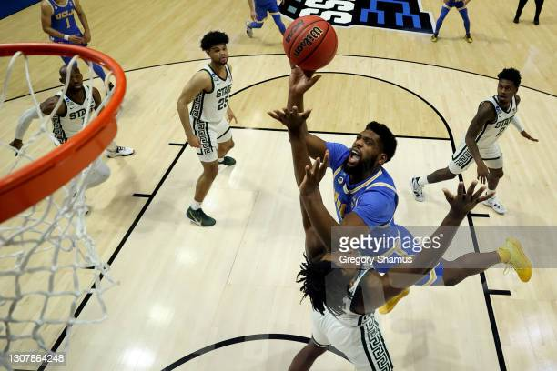 Cody Riley of the UCLA Bruins attempts a layup against the Michigan State Spartans in the First Four game prior to the NCAA Men's Basketball...