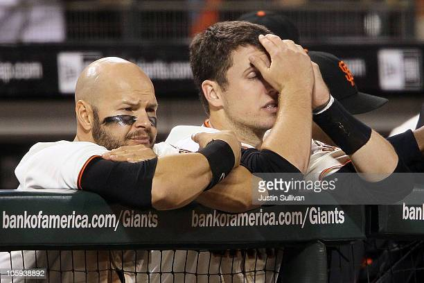 Cody Ross and Buster Posey of the San Francisco Giants react in the ninth inning of Game Five of the NLCS against the Philadelphia Phillies during...