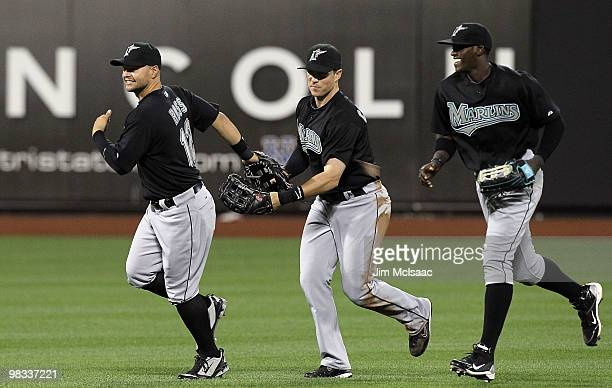 Cody Ross Chris Coghlan and Cameron Maybin of the Florida Marlins celebrate after defeating the New York Mets on April 8 2010 at Citi Field in the...