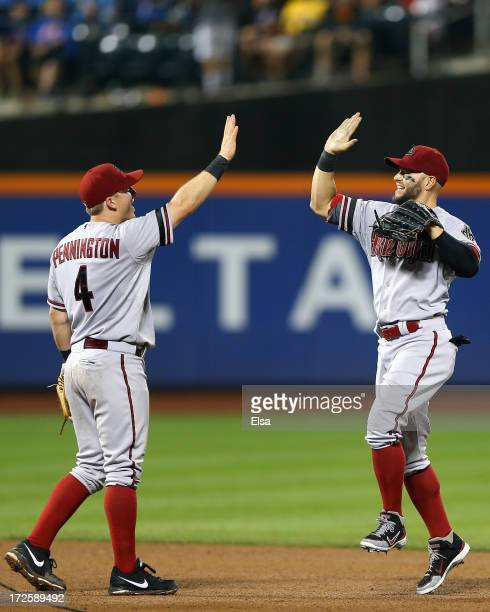 Cody Ross of the Arizona Diamondbacks celebrates the win with teammate Cliff Pennington after the game against the New York Mets on July 3 2013 at...