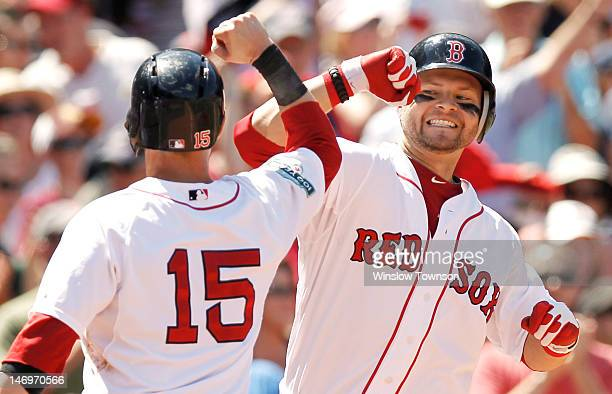 Cody Ross of the Boston Red Sox is greeted by Dustin Pedroia after his threerun home run against the Atlanta Braves during the fourth inning of the...