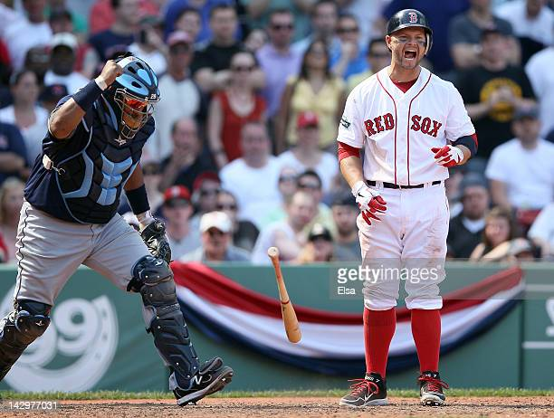 Cody Ross of the Boston Red Sox reacts after striking out to end the inning as Jose Molina of the Tampa Bay Rays celebrates the win on April 16 2012...
