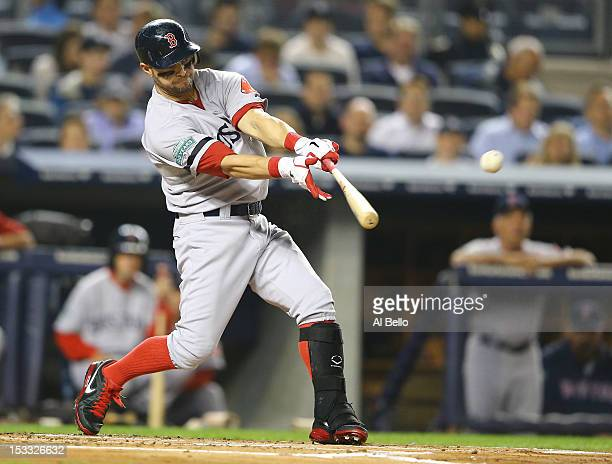 Cody Ross of the Boston Red Sox singles and drives in a run against the New York Yankees during their game on October 3 2012 at Yankee Stadium in the...