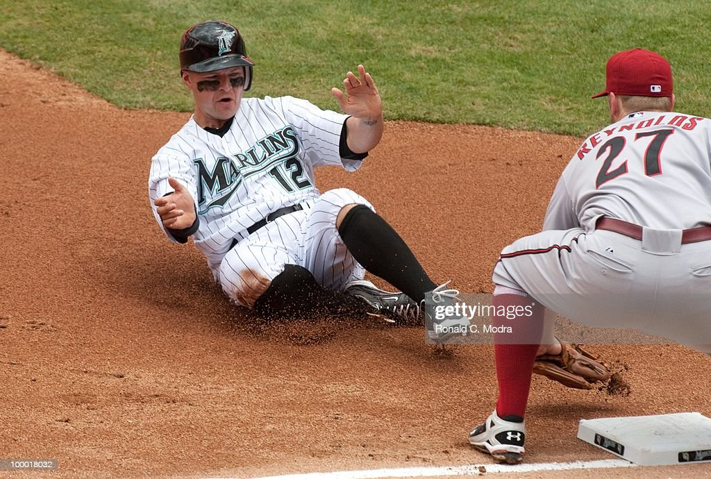 Cody Ross #12 of the Florida Marlins is caught stealing third base as Mark Reynolds #27 of the Arizona Diamondback makes the tag during a MLB game in Sun Life Stadium on May 18, 2010 in Miami, Florida.