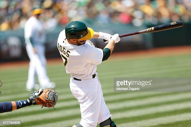 Cody Ross of the Oakland Athletics bats during the game against the Houston Astros at Oco Coliseum on April 25 2015 in Oakland California The Astros...