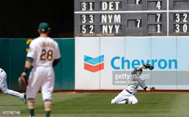 Cody Ross of the Oakland Athletics watches as the ball falls in front of him during the game against the Houston Astros at Oco Coliseum on April 25...