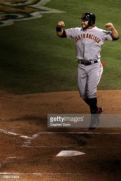 Cody Ross of the San Francisco Giants celebrates after he scored on a 3run home run hit by Edgar Renteria in the seventh inning against the Texas...