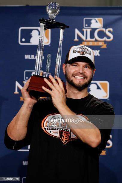 Cody Ross of the San Francisco Giants celebrates with the NCLS MVP trophy after defeating the Philadelphia Phillies 32 and winning the pennant in...