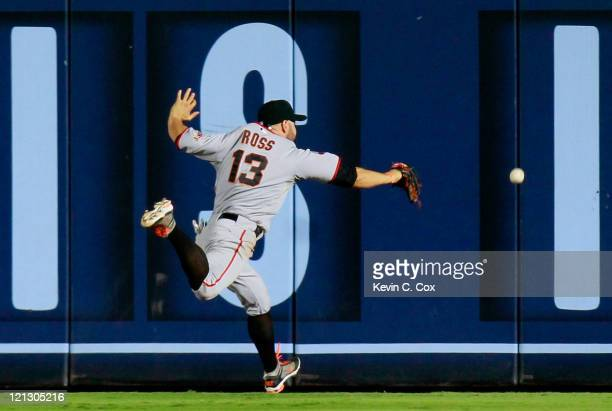Cody Ross of the San Francisco Giants fails to catch a line drive double by Martin Prado of the Atlanta Braves in the ninth inning at Turner Field on...