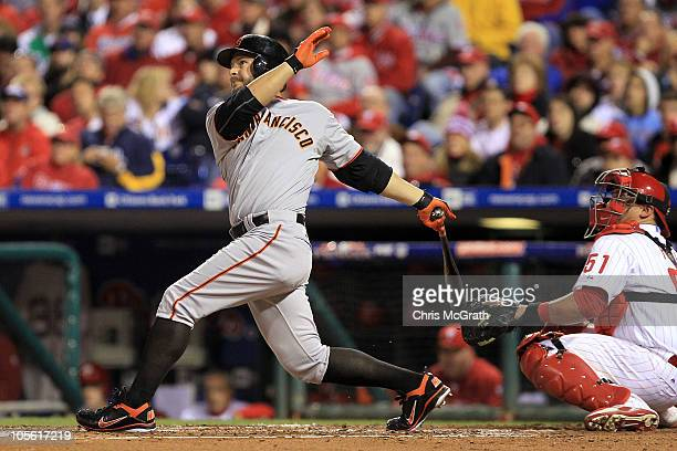 Cody Ross of the San Francisco Giants hits a homerun against the Philadelphia Phillies in the third inning of Game One of the NLCS during the 2010...