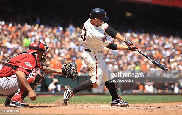 Cody Ross of the San Francisco Giants hits a two run double in the fifth inning against the Arizona Diamondbacks at ATT Park on August 3 2011 in San...