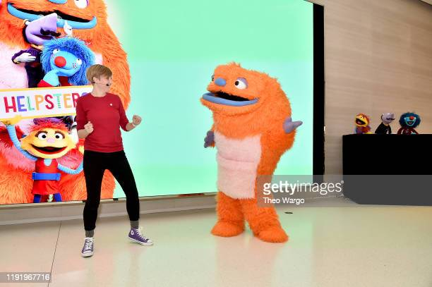 """Cody Scatter Mr Primm and Heart from """"Helpsters"""" a brandnew preschool series from the makers of """"Sesame Street"""" that airs on Apple TV were on hand at..."""