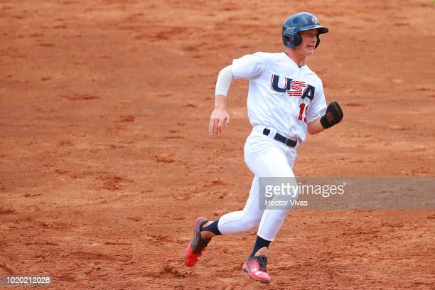 Cody Schrier of United States runs to third base in the 3rd inning during the WBSC U15 World Cup Super Round match between Dominican Republic and USA...