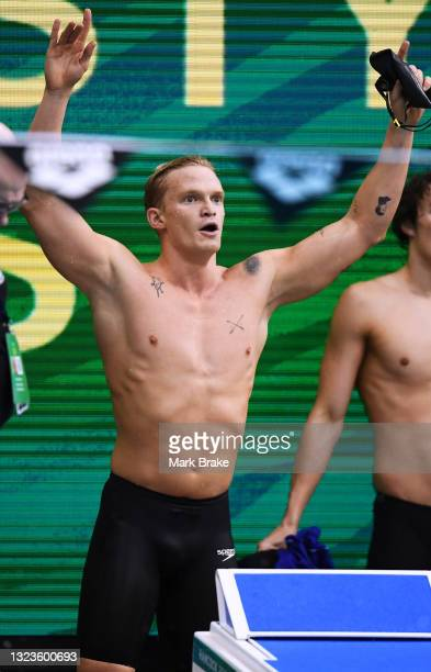 Cody Simpson after winning his Men's 100 metre Freestyle heat cheers o a fellow swimmer in the next heat during the Australian National Olympic...
