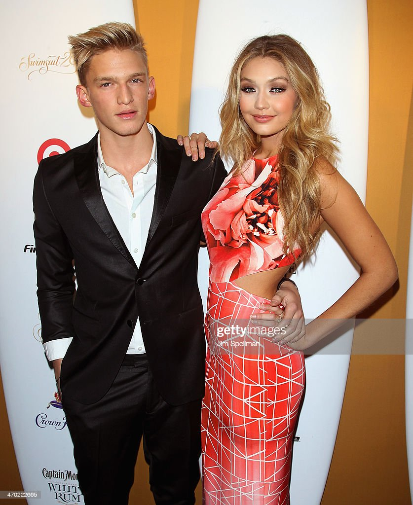 Cody Simpson and model attend the Sports Illustrated Swimsuit 50th Anniversary Party at Swimsuit Beach House on February 18, 2014 in New York City.