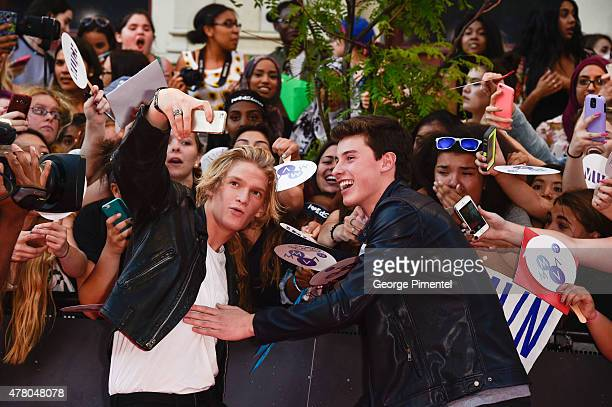 Cody Simpson and Shawn Mendes arrive at the 2015 MuchMusic Video Awards at MuchMusic HQ on June 21 2015 in Toronto Canada