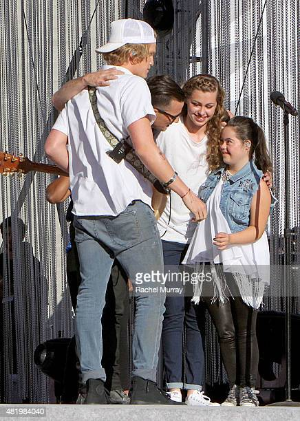 Cody Simpson Marc Roberge of OAR Bree Bogucki and Madison Tevlin open the 2015 Los Angeles Special Olympics World Games by performing the CocaCola...