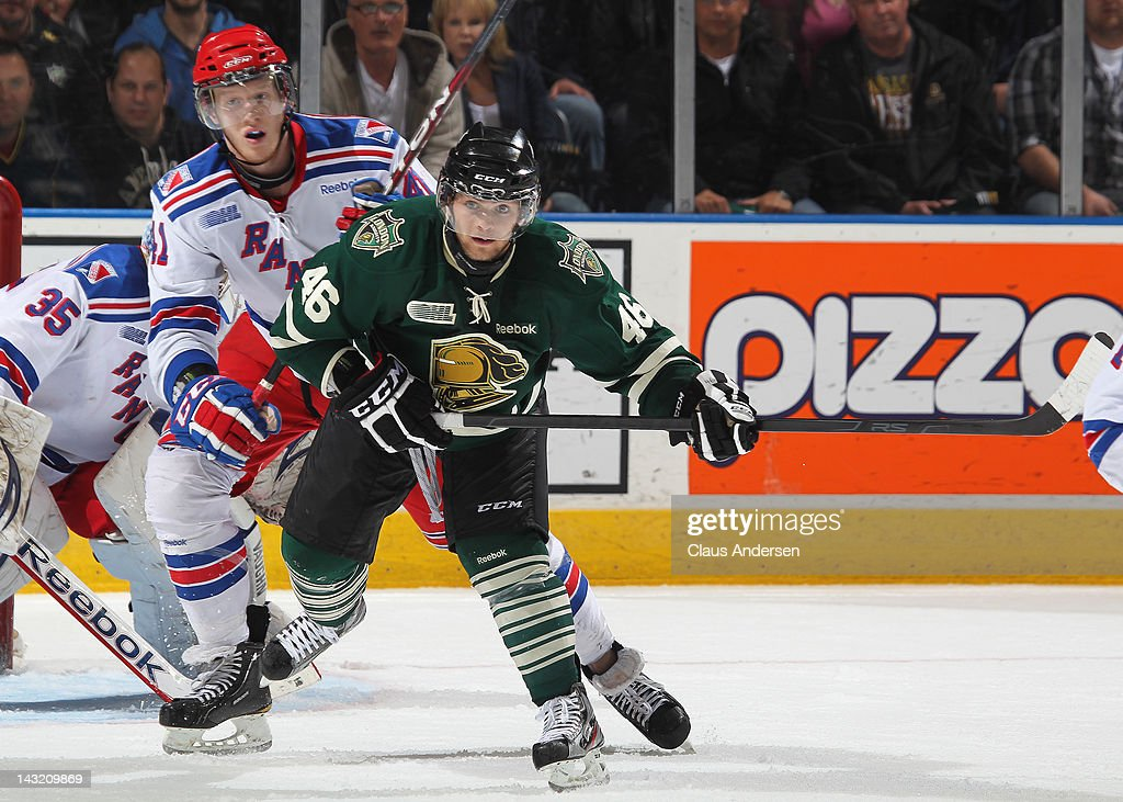 Cody Sol #41 of the Kitchener Rangers ties up Matt Rupert #46 of the London Knights in game 1 of the Western Conference Championship final on April 19, 2012 at the John Labatt Centre in London, Canada. The Knights defeated the Rangers 3-2 in overtime to take a 1-0 series lead.