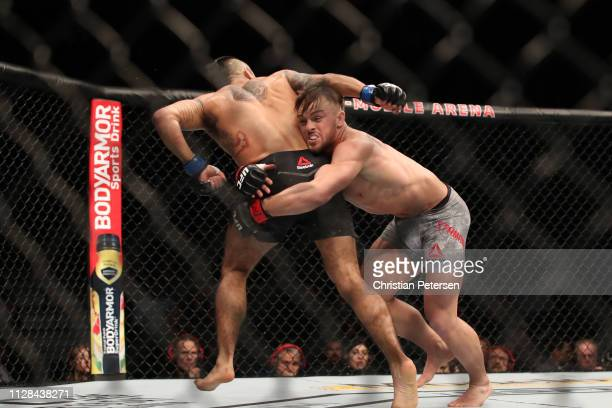 Cody Stamann shoots for a takedown on Alejandro Perez of Mexico in their bantamweight bout during the UFC 235 event at T-Mobile Arena on March 2,...