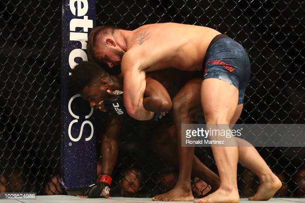Cody Stamann top and Aljamain Sterling in their Bantamweight bout during UFC 228 at American Airlines Center on September 8 2018 in Dallas United...