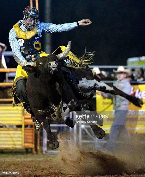 Cody Teece rides his bull at it leeps in mid air during the PBR Bull Riding Competition at the Cunnamulla Fella Festival on August 27 2016 in...