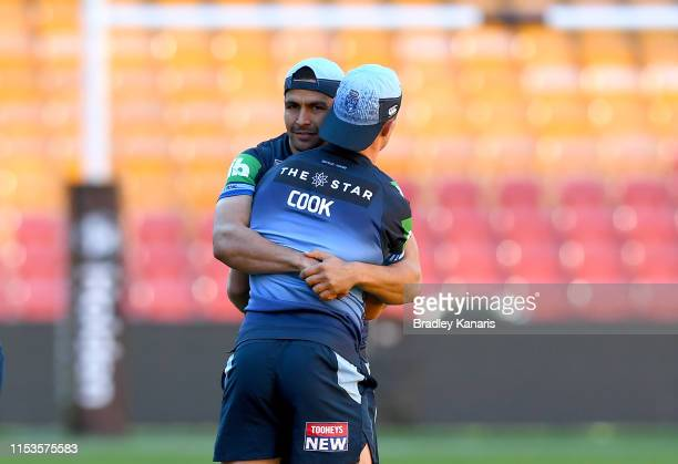 Cody Walker grabs team mate Damien Cook during the New South Wales Blues State of Origin Captain's Run at Suncorp Stadium on June 04, 2019 in...