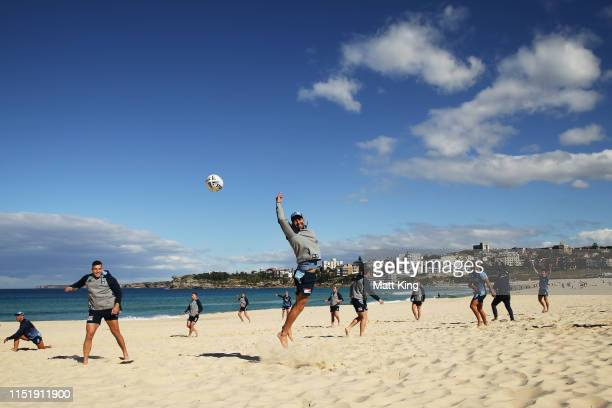 Cody Walker jumps for the ball during a New South Wales Blues State of Origin media opportunity at Bondi Beach on May 27, 2019 in Sydney, Australia.