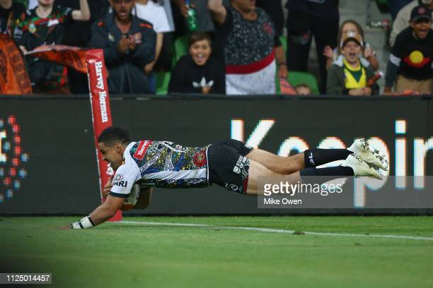 Cody Walker of Indigenous Man's All Stars scores a try during the NRL exhibition match between the Indigenous All Stars and the Maori All Stars at...