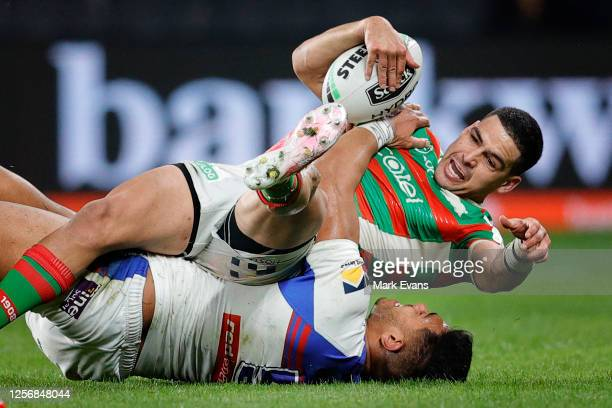 Cody Walker of Souths is tackled during the round 10 NRL match between the South Sydney Rabbitohs and the Newcastle Knights at Bankwest Stadium on...