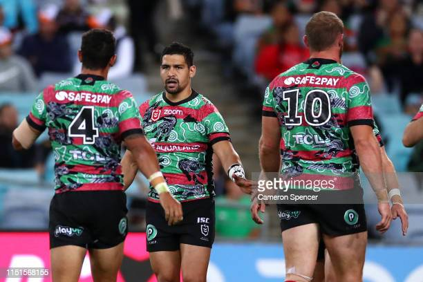 Cody Walker of the Rabbitohs and team mates celebrate a try by team mate Adam Reynolds of the Rabbitohs during the round 11 NRL match between the...
