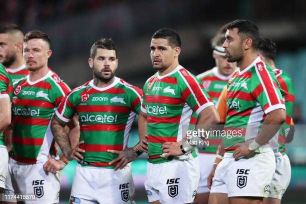 Cody Walker of the Rabbitohs and team mates look dejected after a Roosters try during the NRL Qualifying Final match between the Sydney Roosters and...