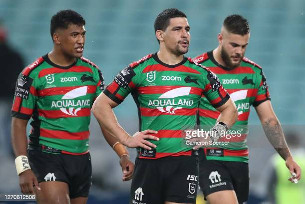 Cody Walker of the Rabbitohs and team mates look dejected after the Rabbitohs were defeated buy the Storm during the round 17 NRL match between the...