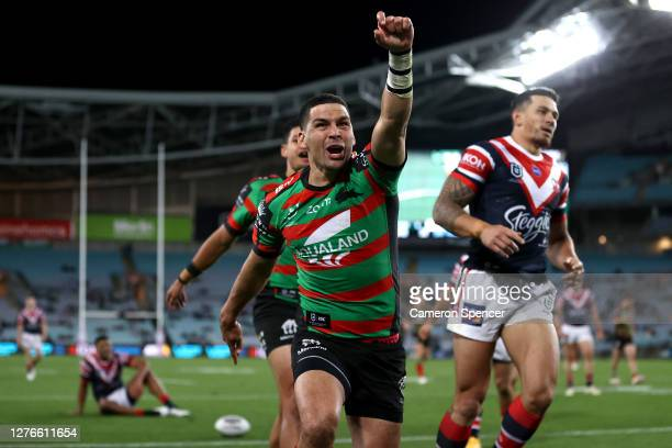 Cody Walker of the Rabbitohs celebrates scoring a try during the round 20 NRL match between the South Sydney Rabbitohs and the Sydney Roosters at ANZ...