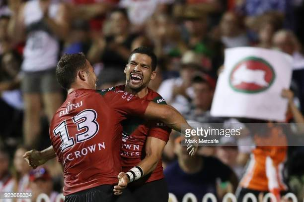 Cody Walker of the Rabbitohs celebrates scoring a try with team mate Sam Burgess of the Rabbitohs during the NRL trial match between the South Sydney...