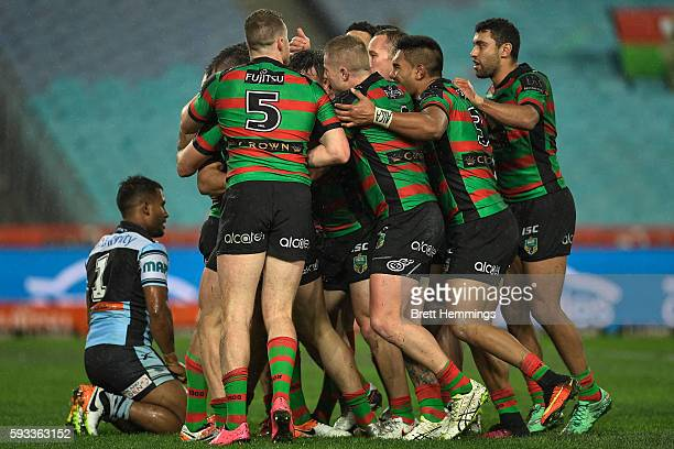 Cody Walker of the Rabbitohs celebrates scoring a try with team mates during the round 24 NRL match between the South Sydney Rabbitohs and the...