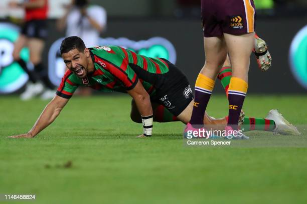 Cody Walker of the Rabbitohs celebrates scoring his second try during the round eight NRL match between the South Sydney Rabbitohs and the Brisbane...