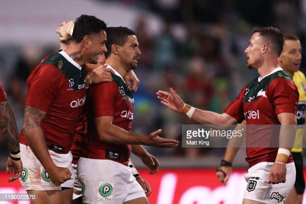 Cody Walker of the Rabbitohs celebrates with team mates after scoring a try during the round 10 NRL match between the Canberra Raiders and the South...