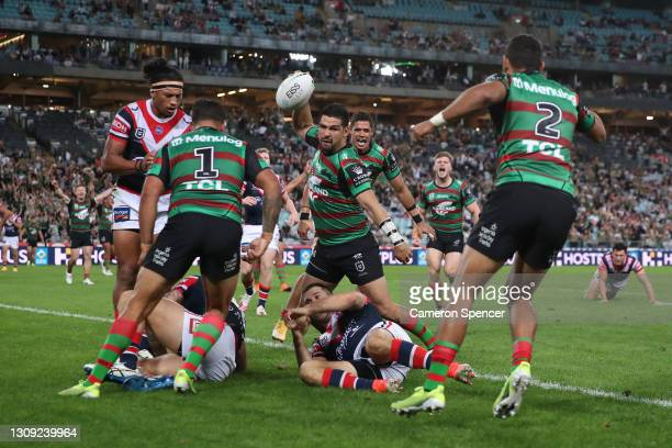 Cody Walker of the Rabbitohs celebrates with team mates after scoring a try during the round three NRL match between the South Sydney Rabbitohs and...