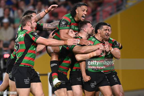 Cody Walker of the Rabbitohs celebrates with team mates after scoring a try during the NRL Preliminary Final match between the South Sydney Rabbitohs...